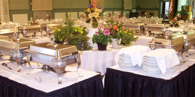 Buffet tables with warmers for a delicious catered meal.